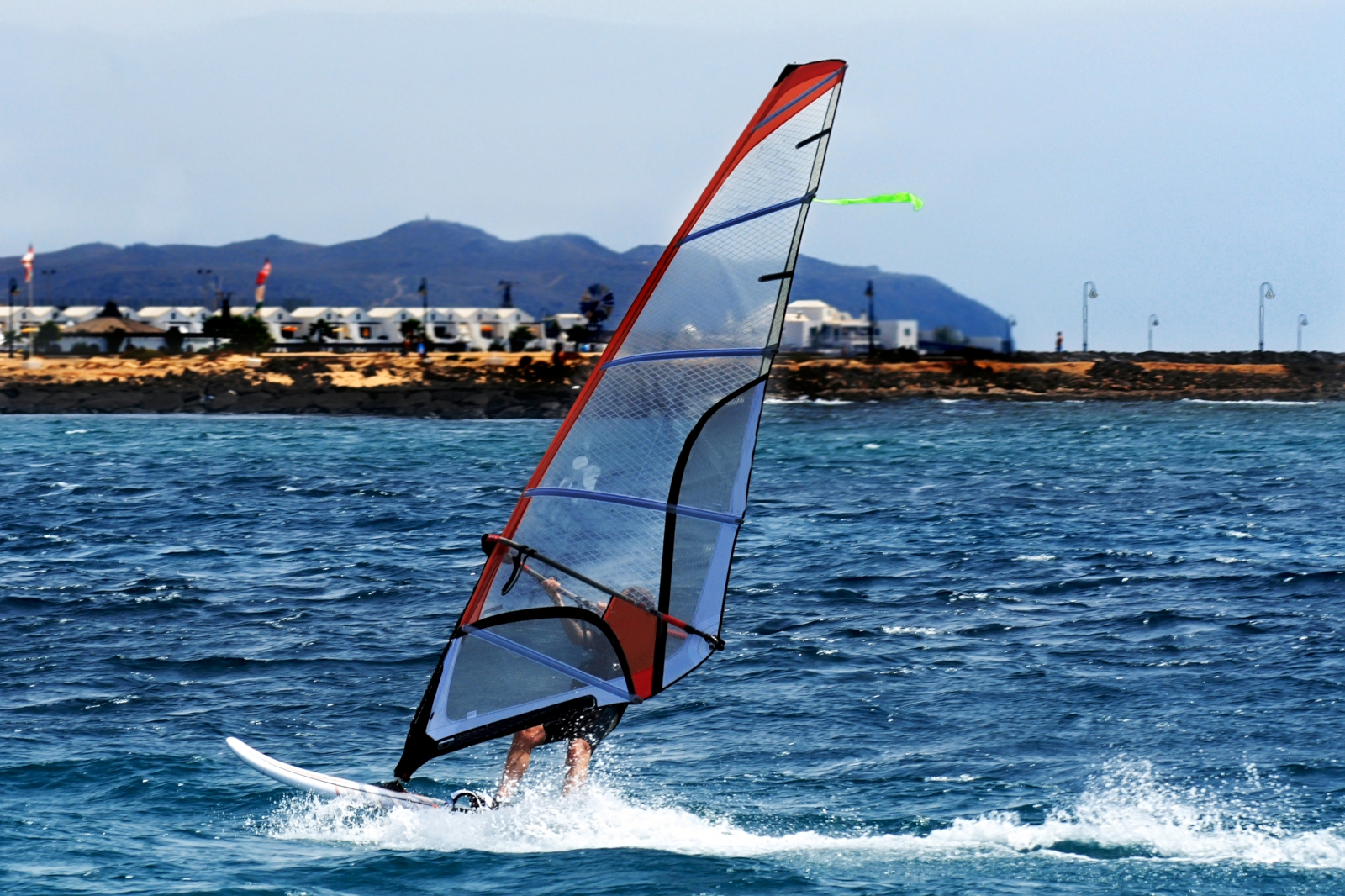 'A windsurfer sailing off the coast of Lanzarote' - Lanzarote