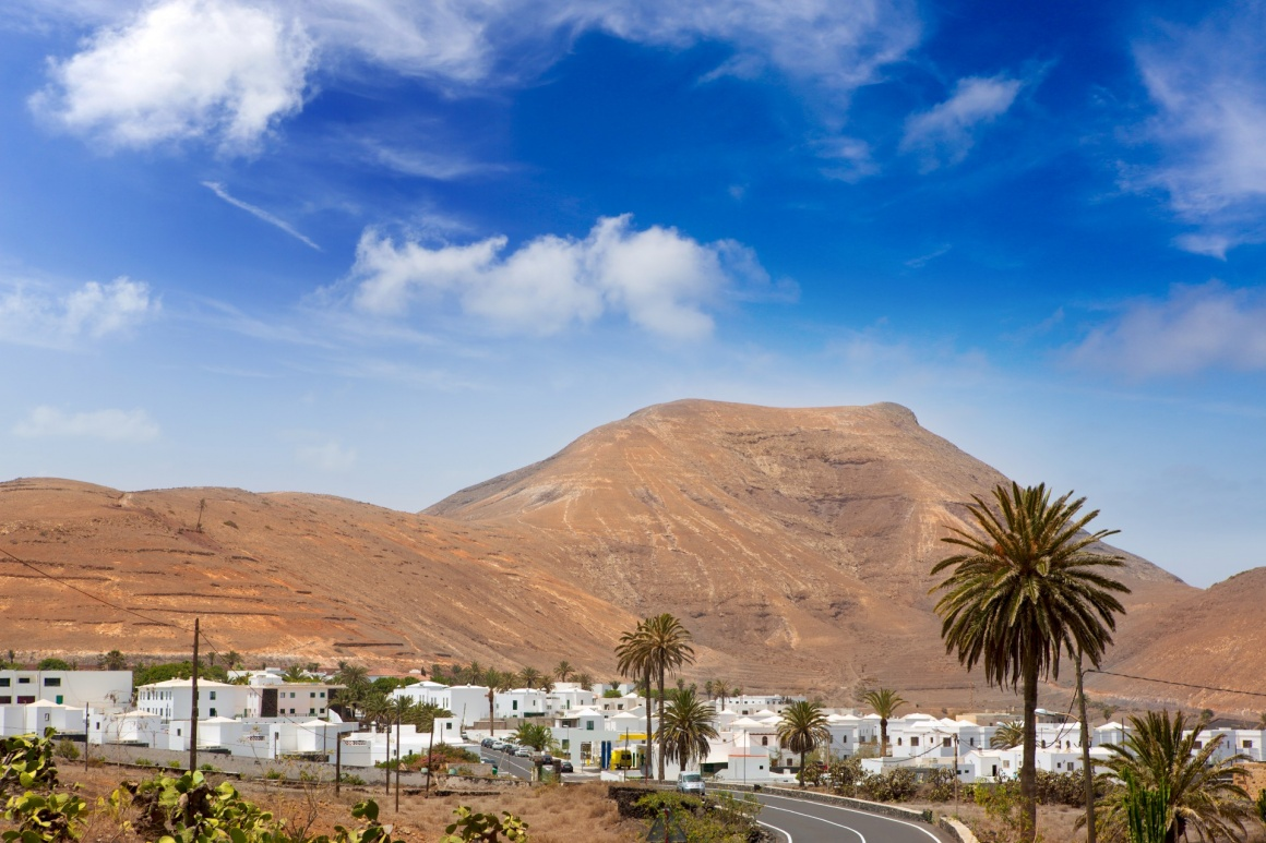 'Lanzarote Yaiza white houses village under volcanic mountains of Canary Islands' - Lanzarote